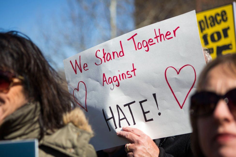 a sign against hate