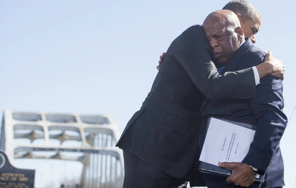Barack Obama (L) hugs US Representative John Lewis near the Edmund Pettus Bridge in Selma