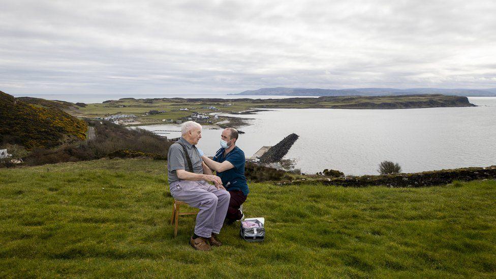 Dr Gavin Chestnut vaccinating a man on Rathlin Island