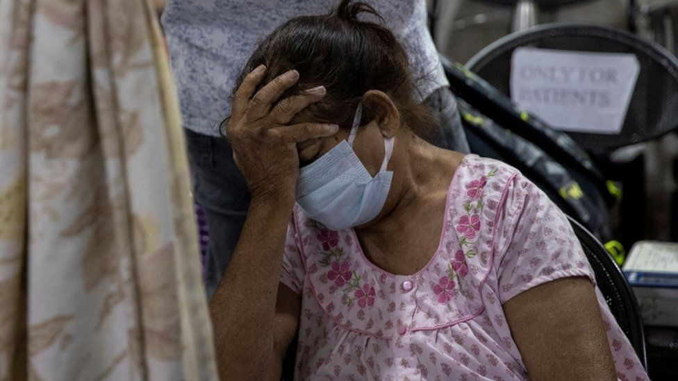 A patient suffering from Covid-19 is seen inside the emergency ward at Holy Family hospital in New Delhi.