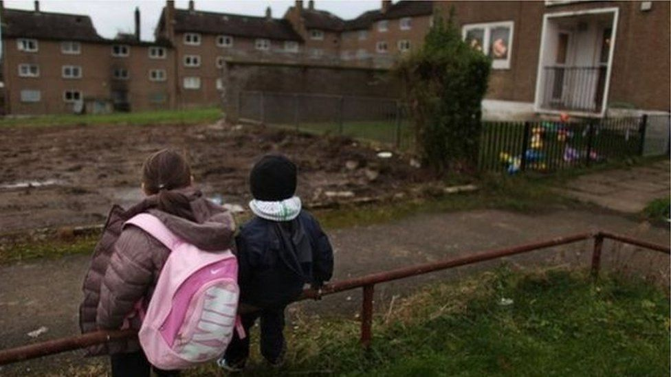 Children looking at homes