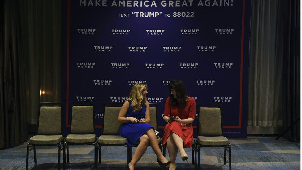 Two women talk ahead of the Trump election night event