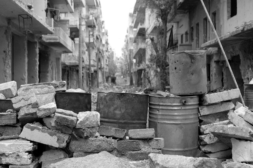 Barricade on abandoned street in eastern Aleppo