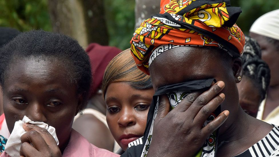 Family members react after looking at the bodies of the children killed in a stampede at the Kakamega Primary School, at the Kakamega County General Teaching Referral Hospital in Kakamega, Kenya February 4, 2020.