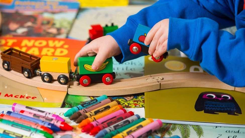 Child playing with toys