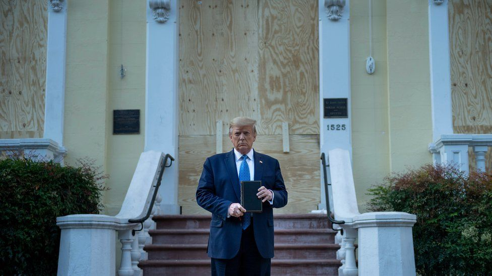 US President Donald Trump holds a Bible while visiting St John's Church across from the White House