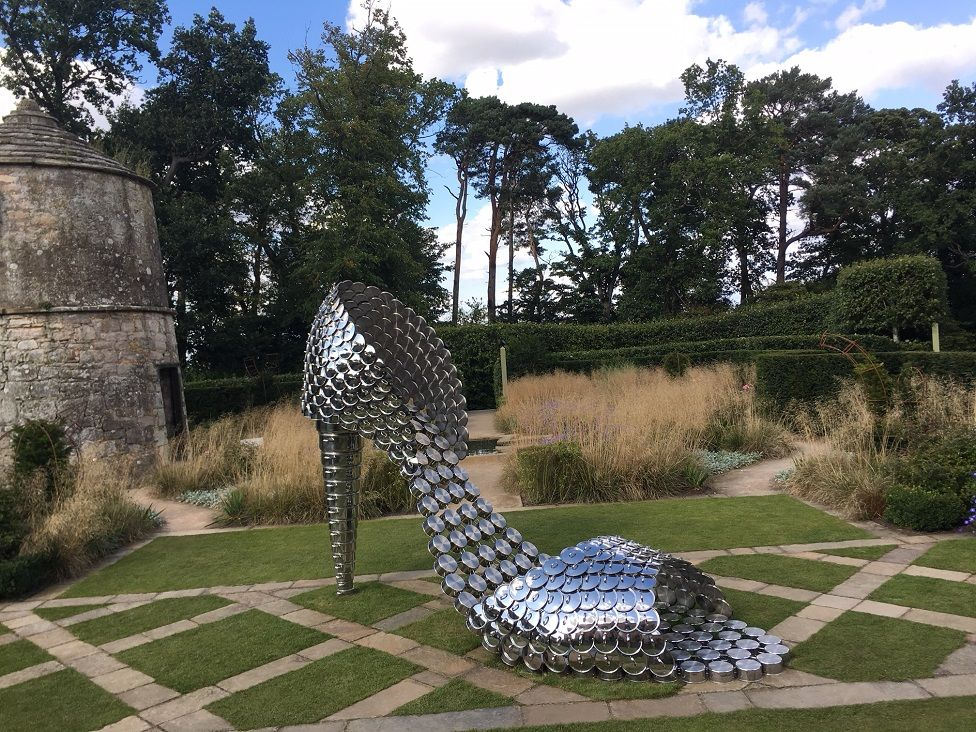 Shoe made out of stainless steel pots and lids at Jupiter Artland