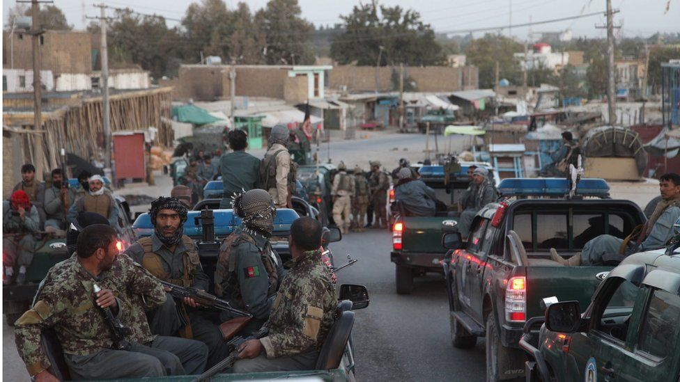 Afghan security forces in pick-up trucks during a counter-offensive to regain control of Kunduz