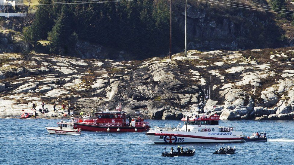 Rescue boats at the scene of the crash