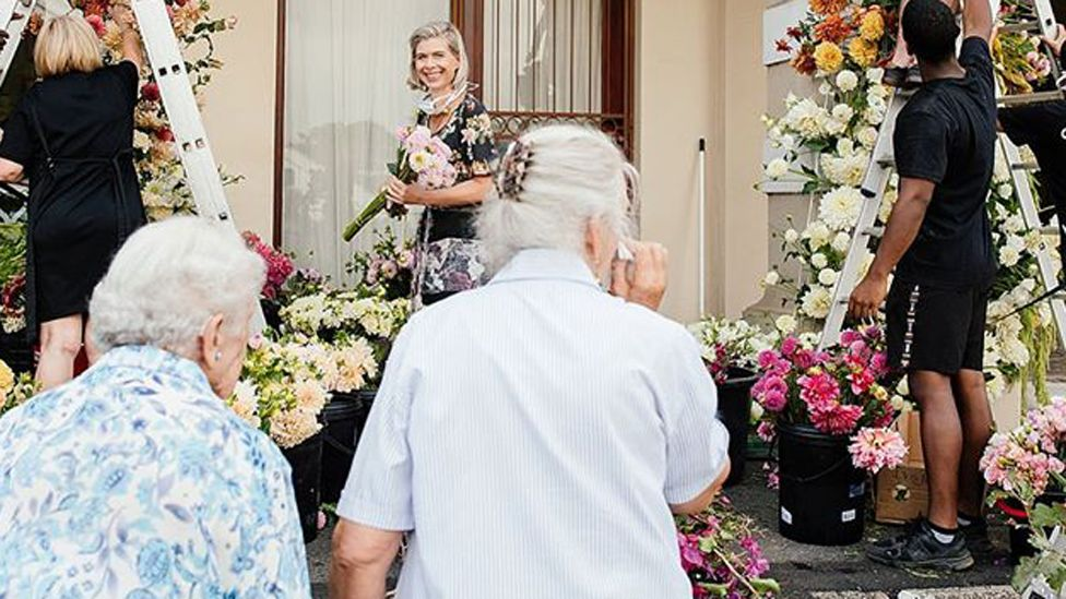 Residents at the Huis Vergenoegd Old Age Home in Paarl, South Africa looking at the flowers