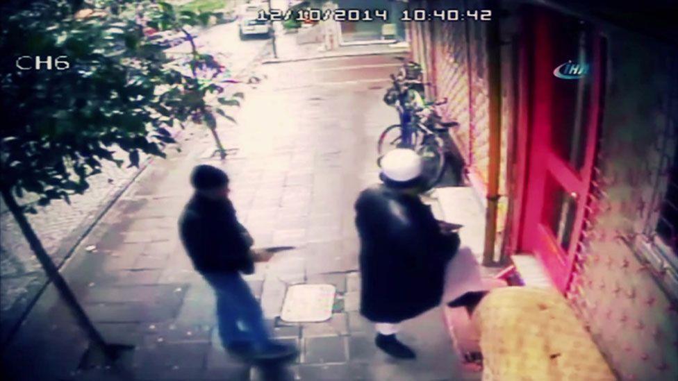 Abdullah Bukhari outside madrassah, with gunman