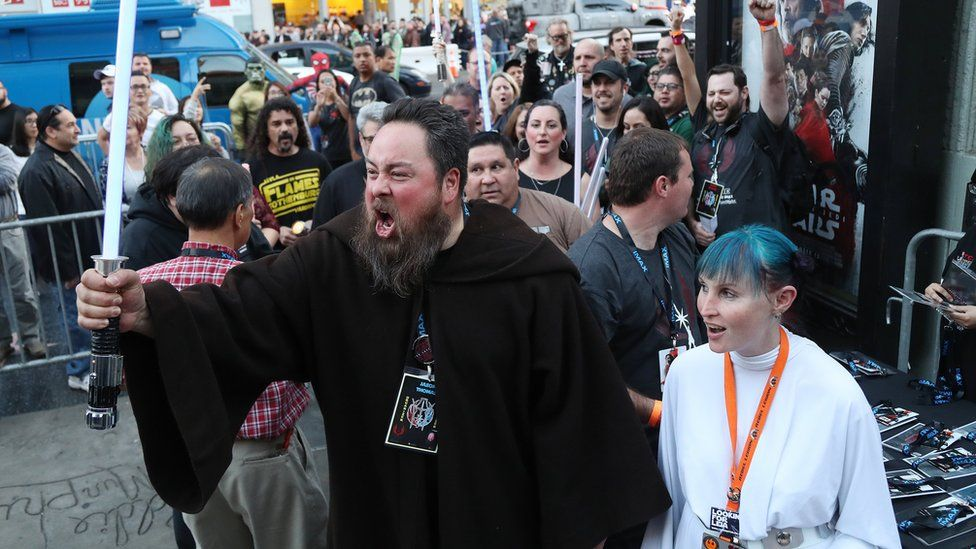 Ticketholders react as they file into the TCL Chinese Theatre for the opening night showings of Star Wars: The Last Jedi.