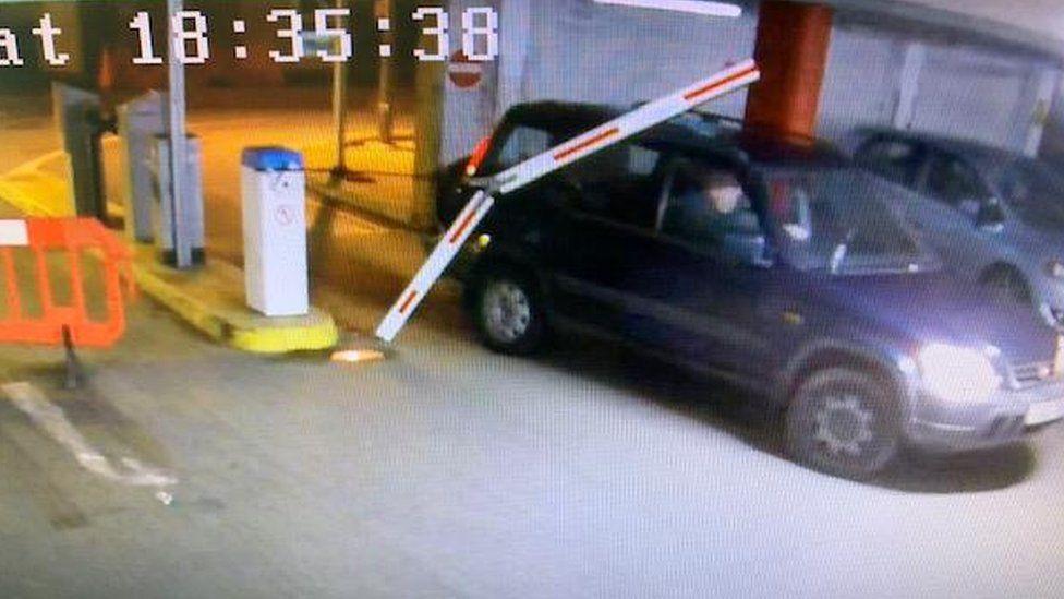 A car driving through a barrier