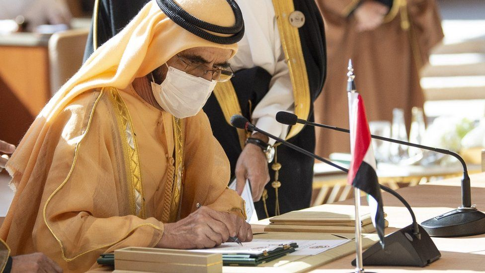 UAE Vice-President and Prime Minister Sheikh Mohammed bin Rashid Al Maktoum signs the al-Ula agreement at the GCC summit in Saudi Arabia (5 January 2020)