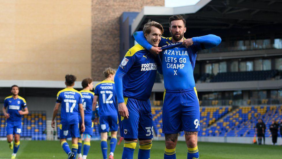 Ollie Palmer and Joe Pigott celebrate a goal