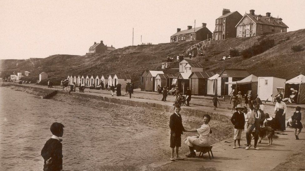 people on the beach in 1904