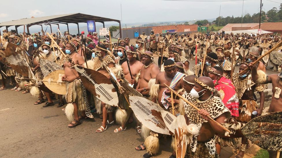 Zulu men in traditional warrior outfits gathered in Nongoma, South Africa - March 2021