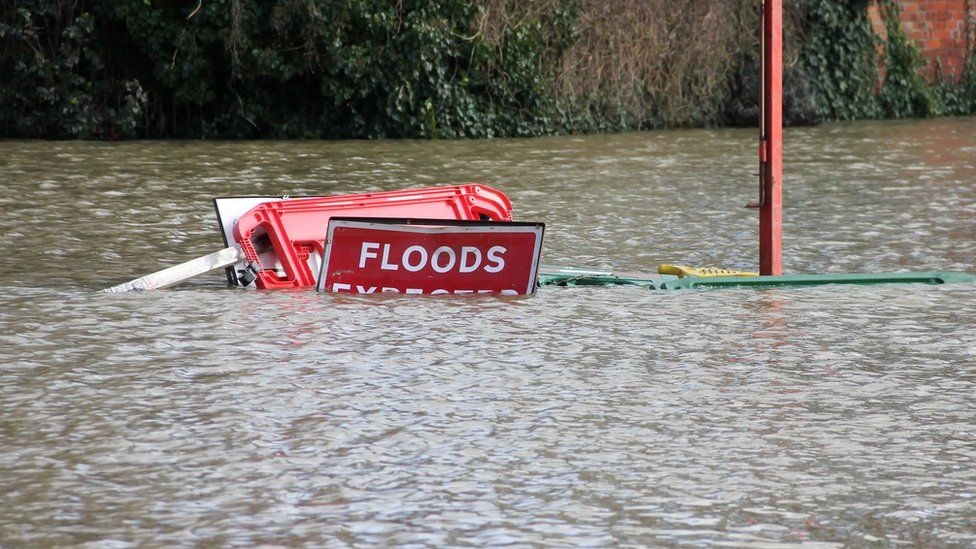 Flood signs underwater as floods have risen over them in Shrewsbury Shropshire during floods in February 2020