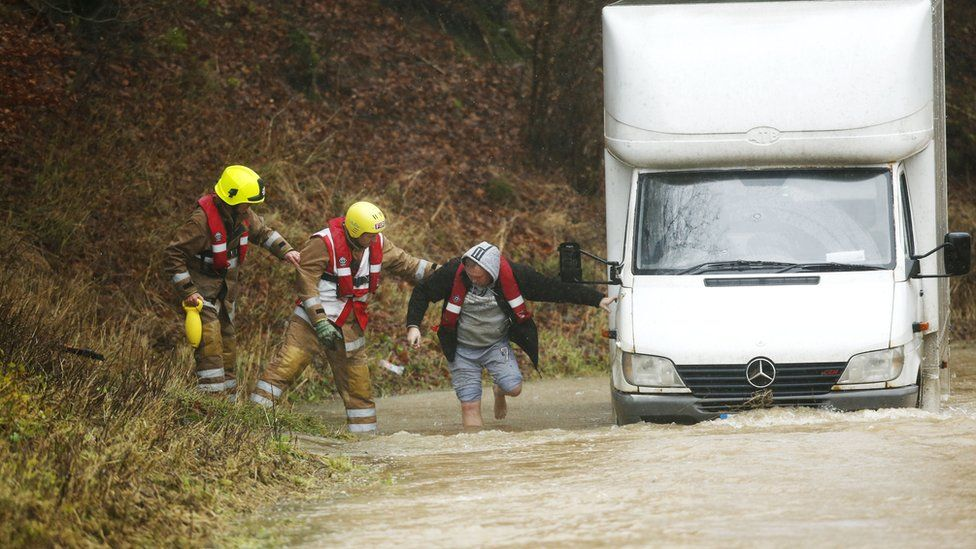 A driver was helped out of his van