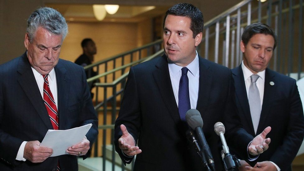 Intelligence committee chairman Devin Nunes (centre) is a prominent Trump supporter