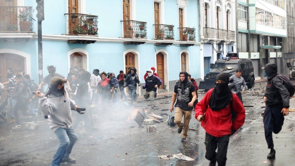 Demonstrators clash with riot police during protests over President Moreno's move to end four-decade-old fuel subsidies