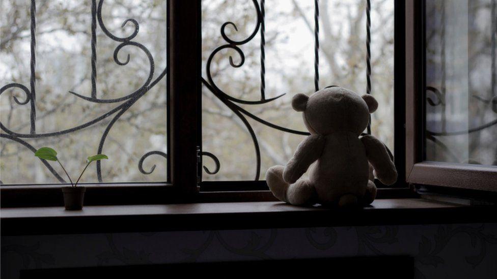 teddy bear at window