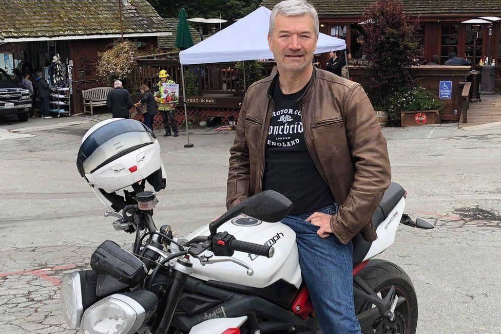 Anthony Shortland sitting on Triumph motorbike