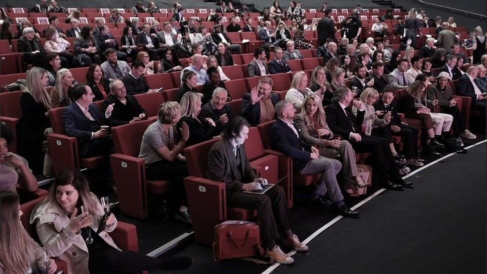 People seated at a business conference