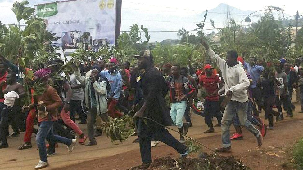 Demonstrators march during a protest against perceived discrimination in favour of the country's francophone majority in Bamenda, Cameroon - September 2017