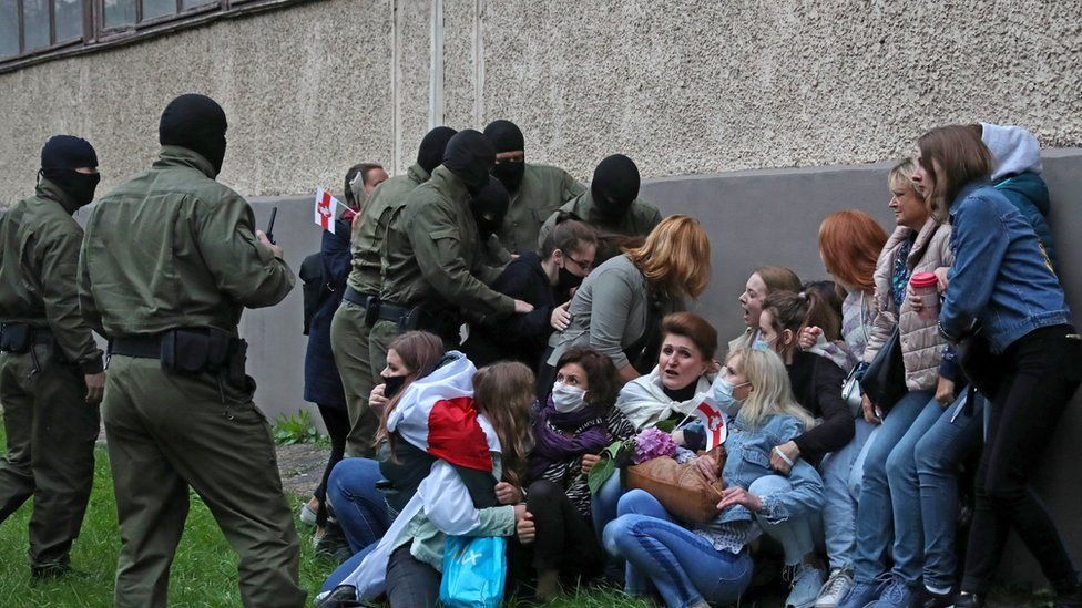Women are detained during a march in support of Maria Kolesnikova and other opposition leaders