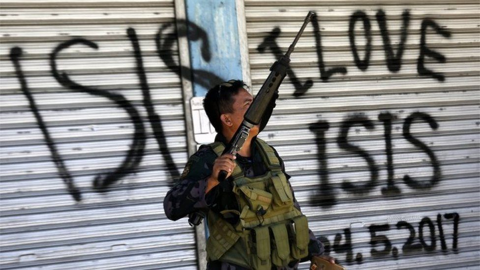 A Filipino government troop conducts patrol on a reclaimed former Maute stronghold in Marawi City, Mindanao Island, southern Philippines, 30 May 2017, as fighting between Islamist militants and government forces continues