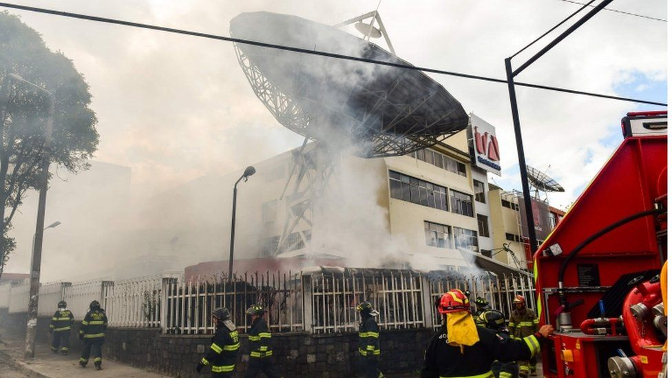 Firefighters work to extinguish a fire at Ecuadorean TV station Teleamazonas offices. 12 Oct 2019