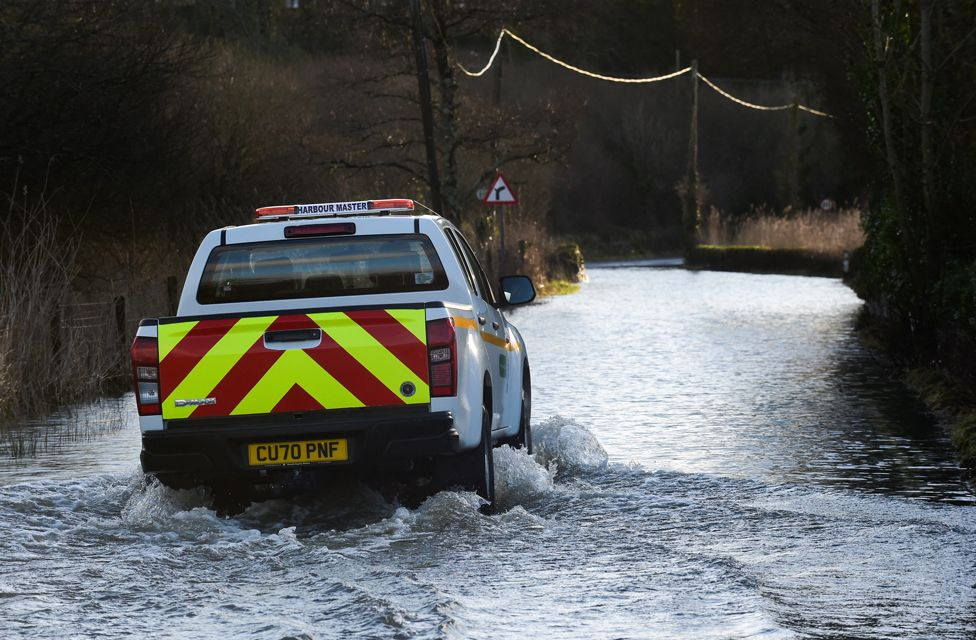 A truck drives through a flooded road in Tenby, 21 January 2021