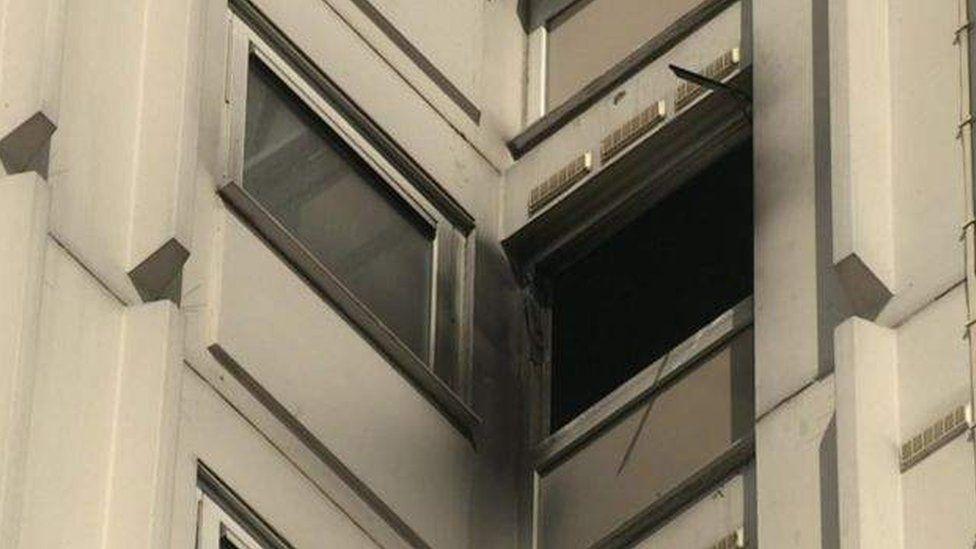 Smoke-damaged windows after tower block fire