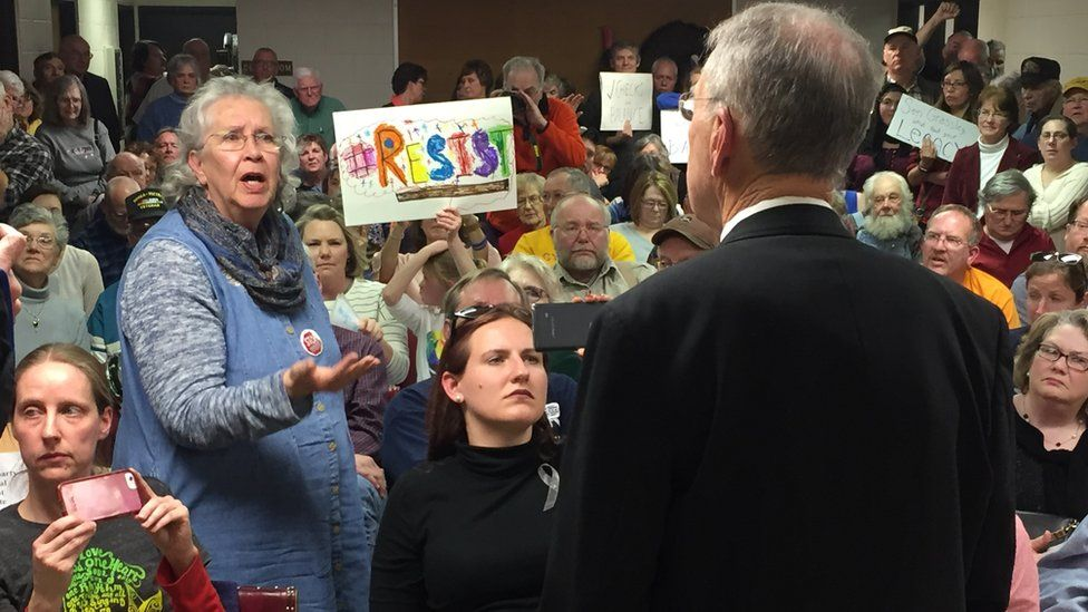 Woman talking to Grassley