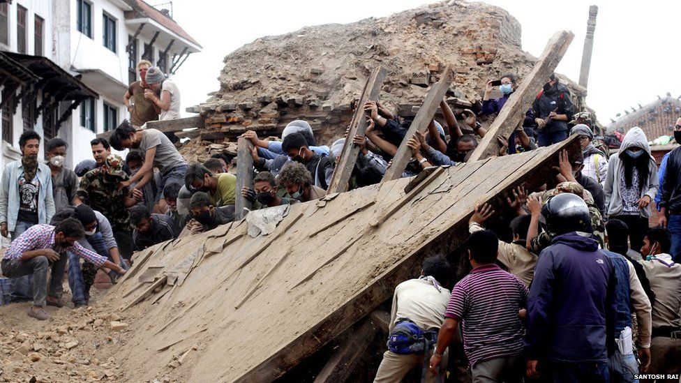 Volunteers help remove wreckage
