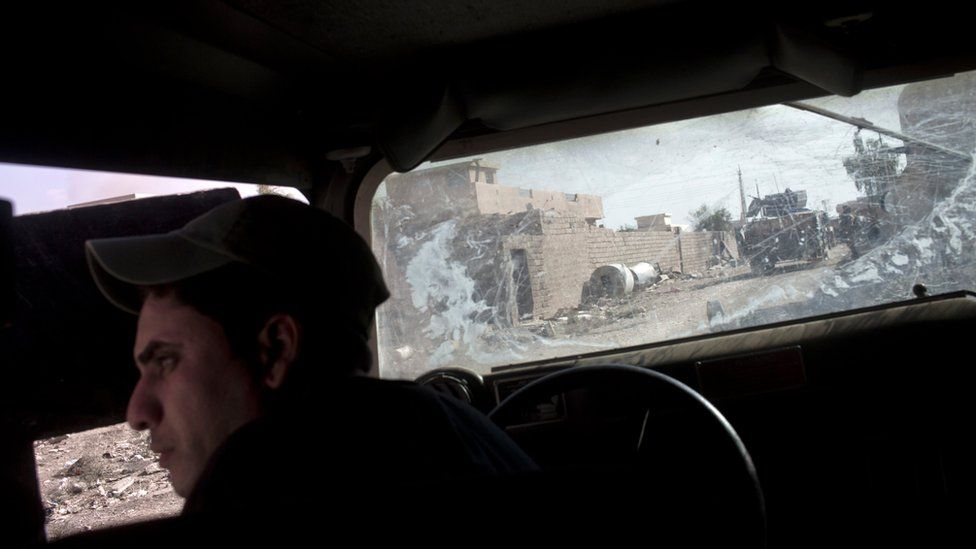 An Iraqi special forces soldier in a Humvee in Bazwaya, east of Mosul
