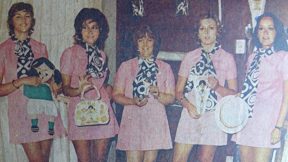 The 1971 translators, holding items of tournament merchandising