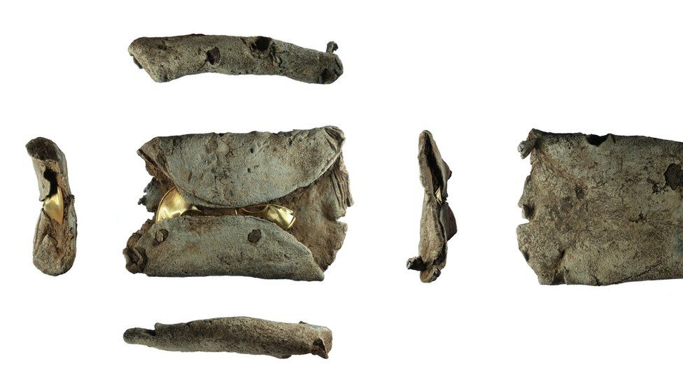 Two late Bronze Age gold lock rings within a lead ingot which has been reused as a sinker