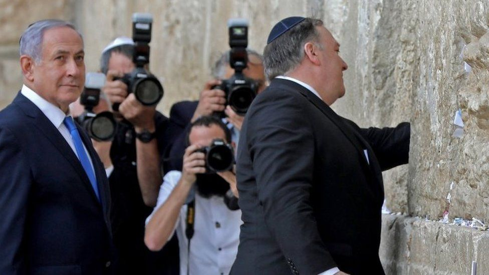 Israeli Prime Minister Benjamin Netanyahu (L) stands by as US Secretary of State Mike Pompeo (R) prays at the Western Wall in Jerusalem's Old City on 21 March 2019,