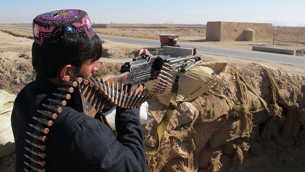 An Afghan Local Police personnel keeps watch during an ongoing battle with Taliban militants in the Marjah district of Helmand Province on 23 December 2015