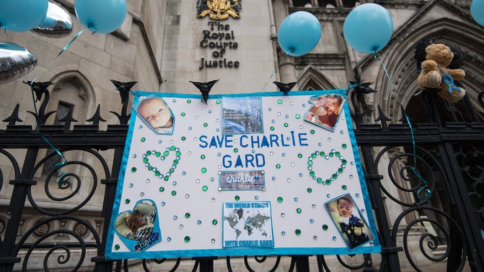 Photo tributes outside the Royal Courts of Justice