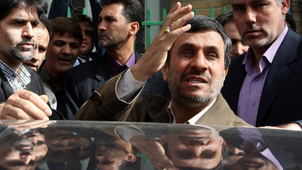 Mahmoud Ahmadinejad waves to supporters outside a polling station in Tehran, in a 2012 picture.