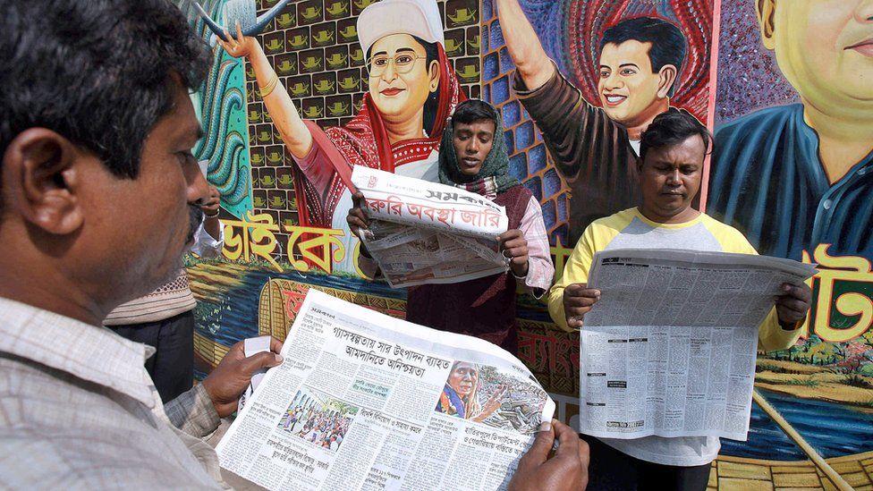 Bangladesh men reading newspapers