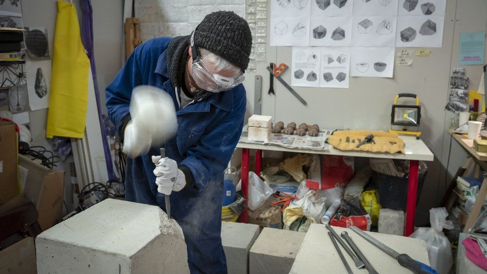 Sculptor Henrietta Armstrong at work in her studio at SET