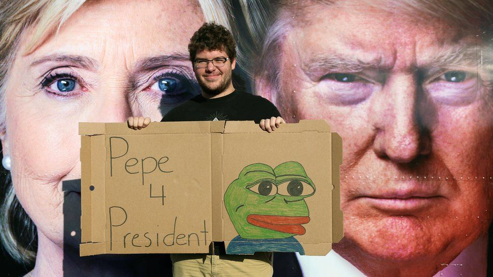 Man with Pepe the Frog sign