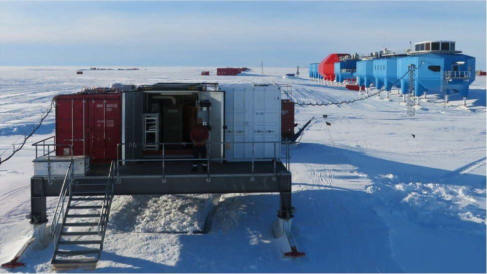 The micro-turbine container and Dobson instrument box stand on a raised platform