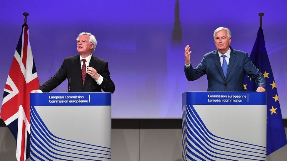 Secretary of State for Exiting the European Union (Brexit Minister) David Davis (L) and EU chief Brexit negotiator Michel Barnier