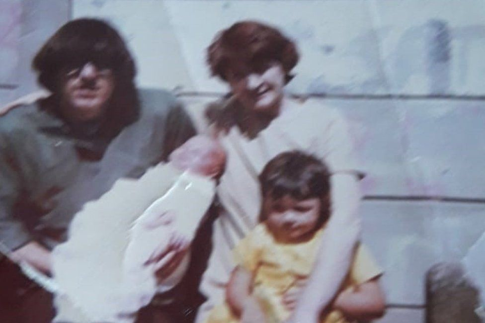 Joan Connolly with her adult son, her young daughter and her first grandchild