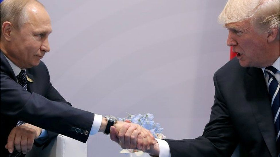 President Putin and President Trump, shaking hands at the G20 summit in Hamburg, Germany in 2017
